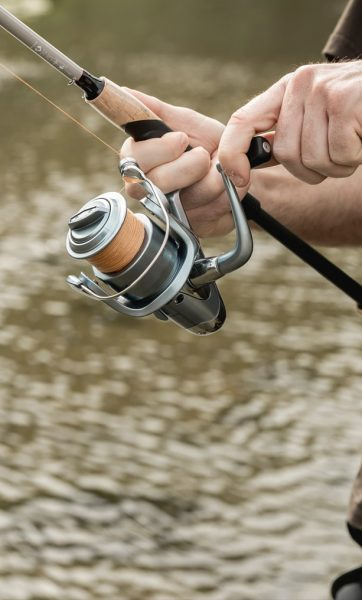 Up close image of man using fishing rod