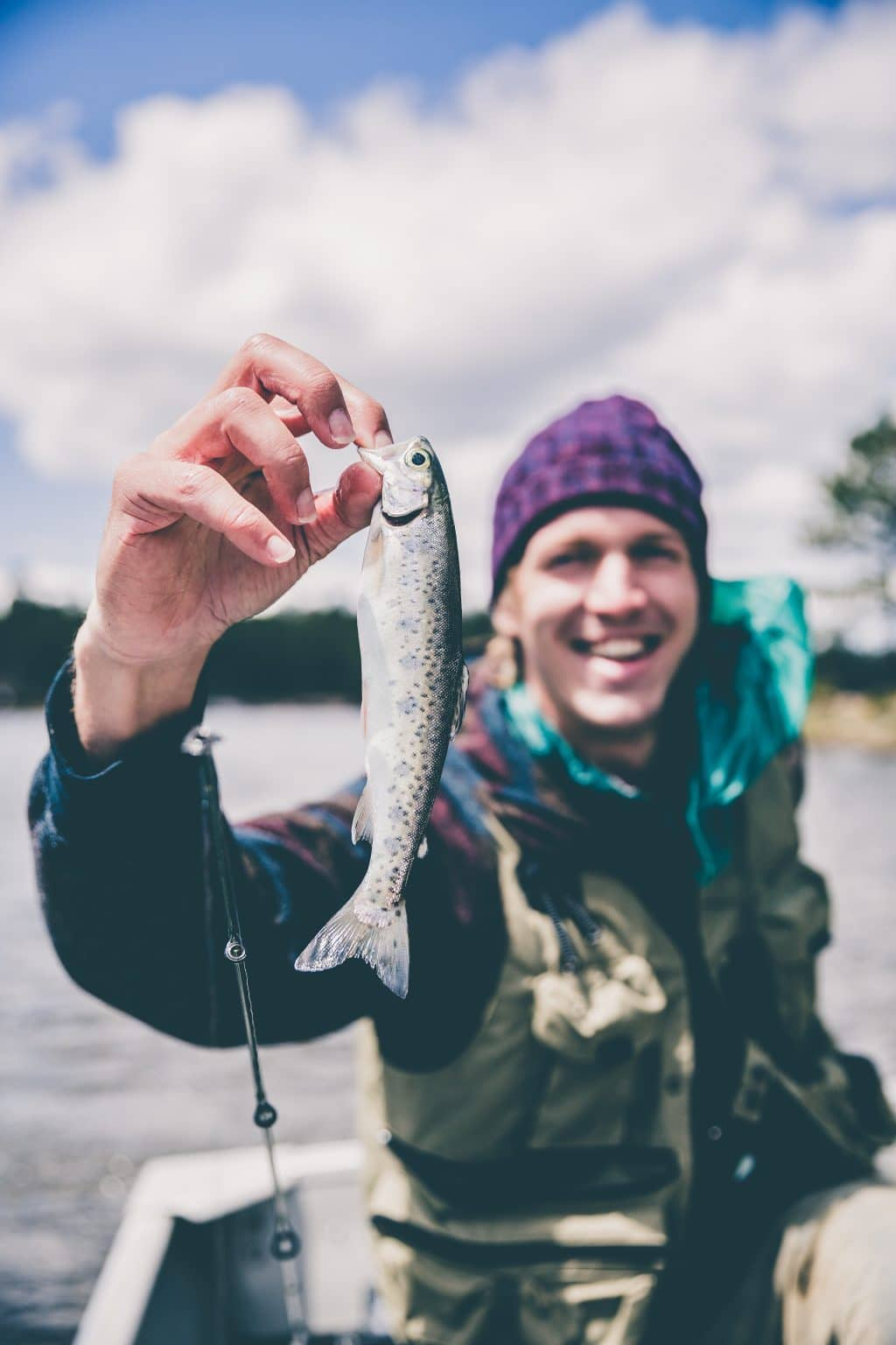 Man Holding Fish 2019